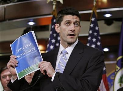 House Budget Chairman Paul Ryan (R-WI) shows a copy of ''The FY2013 Budget - The Path to Prosperity'' during a news conference at Capitol Hill in Washington March 20, 2012. REUTERS/Jose Luis Magana