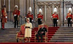 Britain's Queen Elizabeth addresses both Houses of Parliament, next to her husband Prince Philip at Westminster Hall in London March 20, 2012. REUTERS/Kirsty Wigglesworth/POOL