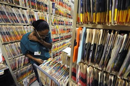 Medical records clerks work in Clinica Sierra Vista's East Bakersfield Community Health Center in Bakersfield, California October 20, 2009. REUTERS/Phil McCarten