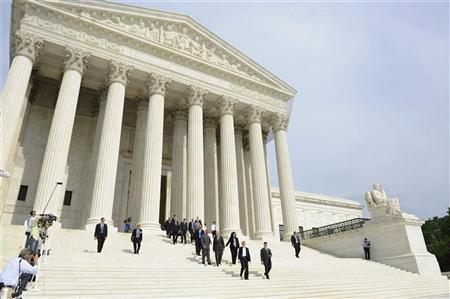 Prince Charles of Britain descends the steps of the U.S. Supreme Court with Justice Stephen Breyer, with their security details, after a reception for Marshall scholarship alumni in Washington May 3, 2011. REUTERS/Jonathan Ernst