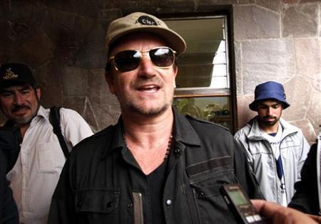 Singer Bono of the band U2 walks at the Inca citadel of Machu Picchu in Cuzco, Febraury 25, 2012. REUTERS/Andina Agency/Handout