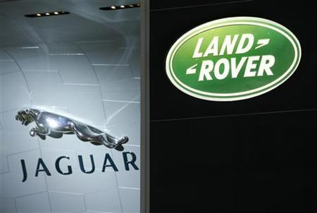 Logos of the carmakers Jaguar and Land Rover are pictured during the first media day of the 78th Geneva Car Show at the Palexpo in Geneva March 4, 2008. REUTERS/Denis Balibouse/Files