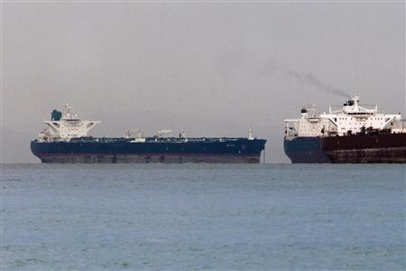 Vessels sail past Malta-flagged Iranian crude oil supertanker ''Delvar'' (L) anchoring off Singapore in this March 1, 2012 file photo. REUTERS/Tim Chong/Files