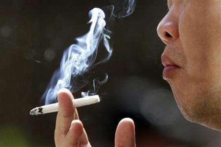A man smokes outside the Taipei railway station January 13, 2010. REUTERS/Pichi Chuang