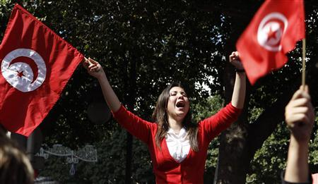 A protester waves flags and shout slogans, during a demonstration in Tunis March 20, 2012. REUTERS/Zoubeir Souissi