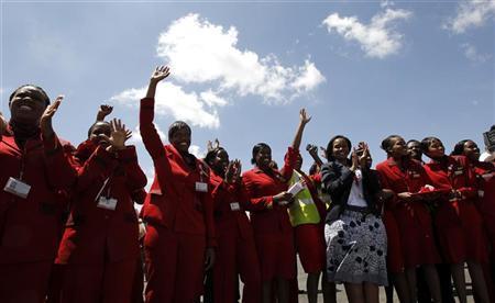 Kenya Airways staff cheer after the Boeing Dreamliner 787-800 made its first landing at the Jomo Kenyatta airport in Kenya's capital Nairobi, December 14, 2011. REUTERS/Thomas Mukoya