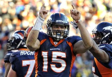Denver Broncos quarterback Tim Tebow celebrates after his team defeated the Pittsburgh Steelers in overtime in the NFL AFC wildcard playoff football game in Denver, Colorado in this January 8, 2012 file photo. REUTERS/Mark Leffingwell