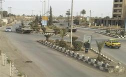 Syrian army tanks are seen in Deir al-Zour city March 21, 2012. REUTERS/Handout