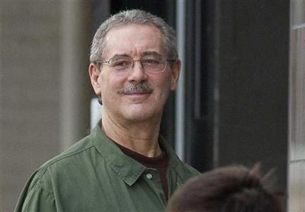 Allen Stanford smiles as he waits to enter the Federal Courthouse where the jury is deliberating in his criminal trial in Houston March 6, 2012. REUTERS/Richard Carson