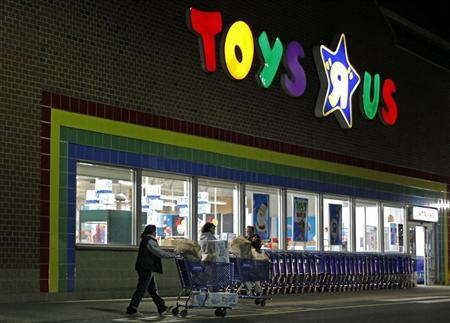 Consumers leave a Toys R Us store with full shopping carts after shopping on the day dubbed ''Black Friday'' in Framingham, Massachusetts November 25, 2011. REUTERS/Adam Hunger