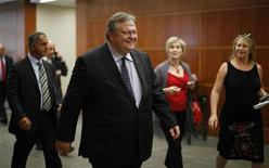 Greek Finance Minister Evangelos Venizelos (C) is followed by journalists as he arrives at an Institute of International Finance meeting in Washington, July 25, 2011. REUTERS/Jason Reed