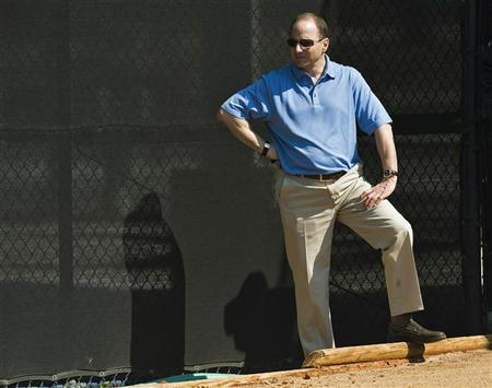 New York Yankees general manager Brian Cashman watches a bullpen session at the team's spring training camp at George M. Steinbrenner Field in Tampa, Florida, February 16, 2011. REUTERS/Steve Nesius