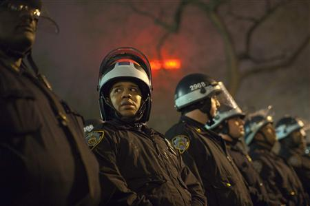 Police officers stand together at Union Square in New York March 22, 2012. More than 100 protesters from the reawakened Occupy Wall Street movement were ejected from Union Square Park early Wednesday after a standoff with police resulted in six arrests. REUTERS/Andrew Kelly