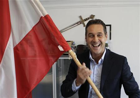 Austrian Freedom Party leader Heinz-Christian Strache holds the Austrian flag in his office in Vienna March 21, 2012. REUTERS/Leonhard Foeger