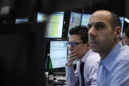 Traders concentrate on their screens at the Frankfurt stock exchange February 2, 2012. REUTERS/Alex Domanski/Files