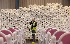Mattresses for the London 2012 Olympics village and crowd control chairs for Olympic officials are stored in the UPS warehouse in Tilbury, southern England February 27, 2012. REUTERS/Olivia Harris