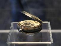 A pocket watch recovered from the RMS Titanic is on display during the Titanic Auction preview by Guernsey's Auction House in New York January 5, 2012. The biggest collection of Titanic artifacts is to be sold off as a single lot in an auction timed for the 100th anniversary in April of the sinking of the famed ocean liner. REUTERS/Brendan McDermid