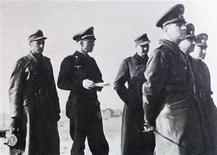 German photographer, Hans Ertl (far left), walks in the Sahara Desert behind a group of German Nazi officers, including their commander, Erwin Rommel (front right), in this undated file photo. Ertl, who photographed the North Africa campaign for Rommel, as well as the 1936 Olympic Games in Berlin for Adolf hitler, has lived nearly half a century in the tropical east of Bolivia.