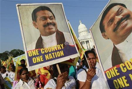 Sri Lankans march as they carry President Mahinda Rajapaksa's images during a ceremony to oppose a U.N. resolution calling on Sri Lanka to probe for wartime human rights abuses in Colombo March 22, 2012. REUTERS/Dinuka Liyanawatte