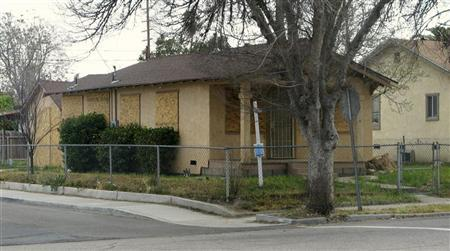 A boarded up home is pictured in California's Inland Empire, which comprises two counties, Riverside and San Bernardino in this photograph taken April 14, 2009. REUTERS/Dan Whitcomb