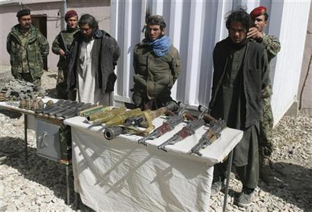 Captured Taliban insurgents and their weapons are presented to the media in Ghazni province March 22, 2012. REUTERS/Mustafa Andaleb