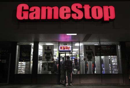 People enter a GameStop store during ''Black Friday'' sales in Carle Place, New York in this file photo taken November 25, 2011. Video game retailer GameStop Corp posted lower sales which missed expectations and its profit fell by more than 25 percent in the holiday quarter, as customers turned to the Internet and the company's rivals. For the fourth quarter ended Jan. 28, GameStop's sales fell 3 percent to $3.58 billion, which missed analyst expectations of $3.71 billion, according to Thomson Reuters. REUTERS/Shannon Stapleton/Files