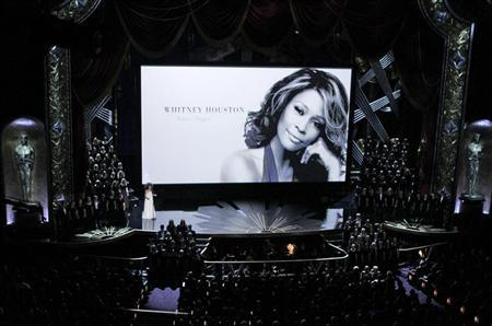 Esperanza Spalding sings as a portrait of Whitney Houston is displayed on the screen during the memorial segment at the 84th Academy Awards in Hollywood, California, February 26, 2012. REUTERS/Gary Hershorn