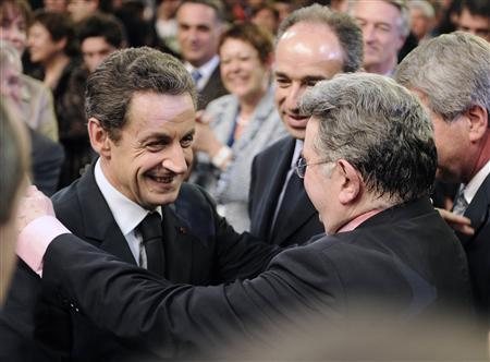 France's President and UMP party candidate for the 2012 French presidential elections Nicolas Sarkozy (L) embraces former Socialist Education minister Claude Allegre as he arrives to deliver a speech at a political rally in Strasbourg, March 22, 2012. REUTERS/Eric Feferberg/Pool