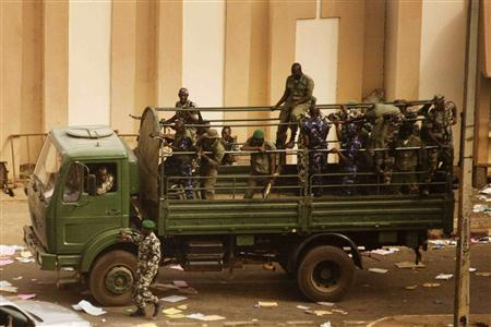 Malian soldiers and security forces gather at the offices of the state radio and television broadcaster after announcing a coup d'etat, in the capital Bamako, March 22, 2012. Renegade Malian soldiers went on state television on Thursday to declare they had seized power in protest at the government's failure to quell a nomad-led rebellion in the north. REUTERS/Malin Palm