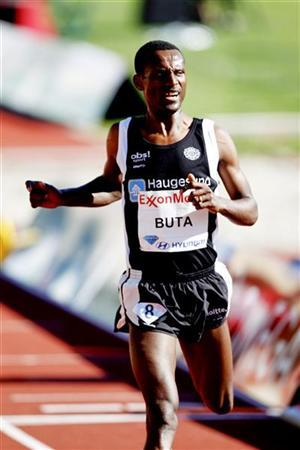Arado Urige Buta of Ethiopia crosses the finish line to win the 5000m national class at the Bislett Games in Oslo, June 4, 2010. REUTERS/Scanpix/Lise Aserud