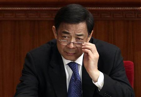 China's Chongqing Municipality Communist Party Secretary Bo Xilai adjusts his glasses during the opening ceremony of the Chinese People's Political Consultative Conference (CPPCC) at the Great Hall of the People, in this file picture taken March 3, 2012. REUTERS/Jason Lee/Files