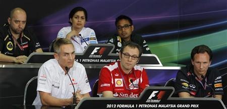 Formula One team chief executive officers, chairmans and team principals attend a news conference following the second practice session of the Malaysian F1 Grand Prix at Sepang International Circuit outside Kuala Lumpur March 23, 2012. Top row from L to R: Lotus F1 chairman Gerard Lopez, Caterham CEO Riad Asmat and Sauber CEO Monisha Kaltenborn. Front row from L to R: McLaren team principal Martin Whitmarsh, Ferrari team principal Stefano Domenicali and Red Bull team principal Christian Horner. REUTERS/Edgar Su
