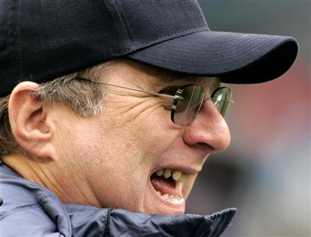 Microsoft Corp co-founder and Seattle Seahawks owner Paul Allen enjoys a laugh while out on the field before the start of his NFC playoff game against the Washington Redskins in Seattle, Washington January 14, 2006. REUTERS/Robert Sorbo