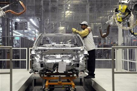 Volkswagen autoworker Greg Wood works in the chisel checks department in the company December 1, 2011. REUTERS/Billy Weeks