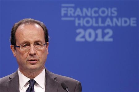 Francois Hollande, Socialist party candidate for the 2012 French presidential election, speaks to the media from his campaign headquarters in Paris March 22, 2012.REUTERS/Benoit Tessier