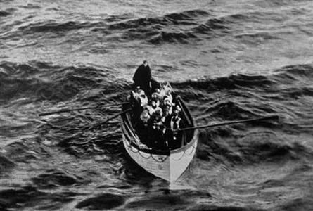 A lifeboat approaches the rescue ship Carpathia, which aided in the rescue of passengers after the luxury liner RMS Titanic sank on her maiden voyage, in this undated handout picture. The Titanic sank one hundred years ago this year, on April 15, 1912, with the loss of 1,517 lives three hours after the ship struck an ice berg. ''TITANIC: The Tragedy That Shook the World,'' by the editors of LIFE at Time Home Entertainment Inc, includes photos and stories of the ship and many of those characters that have kept the public enthralled since the sinking. REUTERS/Ralph White/Corbis/Courtesy of LIFE Books/Handout