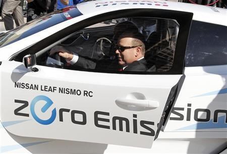 Prince Albert II of Monaco arrives driving a Nissan car 100 per cent electric and with zero emission for a visit at the EVER Monaco 2012, a trade show dedicated to Ecological Vehicles and Renewable Energies, in Monte Carlo, March 22, 2012.  REUTERS/Eric Gaillard