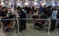 Air Canada travellers wait at the check-in area as baggage handlers at Pierre Elliott Trudeau airport walked off the job, causing cancellations and delay, in Montreal March 23, 2012. REUTERS/Olivier Jean