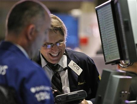 Traders work on the floor of the New York Stock Exchange, March 22, 2012. REUTERS/Brendan McDermid