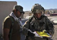 Staff Sgt. Robert Bales, (R) 1st platoon sergeant, Blackhorse Company, 2nd Battalion, 3rd Infantry Regiment, 3rd Stryker Brigade Combat Team, 2nd Infantry Division, is seen during an exercise at the National Training Center in Fort Irwin, California, in this August 23, 2011 DVIDS handout photo. REUTERS/Department of Defense/Spc. Ryan Hallock/Handout