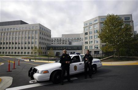 Armed police guard the outside of the National Counterterrorism Center in McLean, Virginia, October 6, 2009. REUTERS/Jason Reed