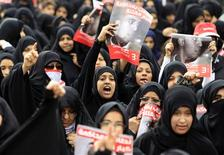 Anti-government protesters chant slogans during a demonstration in the village of Jidhafds, west of Manama, March 23, 2012. REUTERS/Ahmed Jadallah