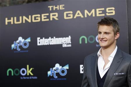 Cast member Alexander Ludwig poses at the premiere of ''The Hunger Games'' at Nokia theatre in Los Angeles, California March 12, 2012. REUTERS/Mario Anzuoni