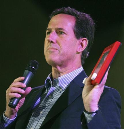 Republican presidential candidate and former U.S. Senator Rick Santorum holds up an ''Etch-a-sketch'' while addressing supporters at a ''Get Out The Vote'' rally in Mandeville, Louisiana March 21, 2012. REUTERS/Sean Gardner