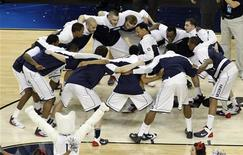 Members of the University Connecticut team huddle before the start of their men's NCAA Final Four Championship basketball game against the Butler Bulldogs in Houston, Texas, in this April 4, 2011 file photograph. The University of Connecticut men's basketball team - last year's national champions - has announced that it cannot meet the new, higher standards for academic performance that the National Collegiate Athletic Association enacted last fall. . REUTERS/Richard Carson/Files