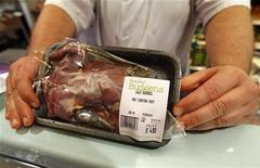 Head Butcher Gary Singleton displays a package of squirrel meat at Budgens supermarket in north London August 6, 2010. REUTERS/Suzanne Plunkett