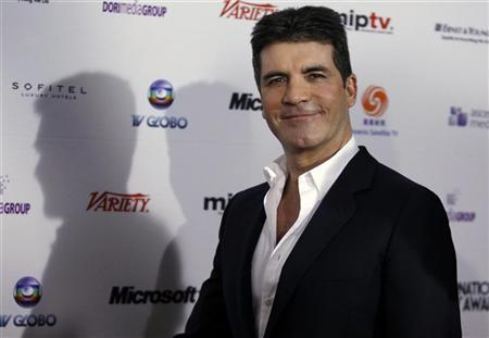 Producer and television star Simon Cowell arrives at the 38th International Emmy Awards in New York City November 22, 2010. REUTERS/Jessica Rinaldi