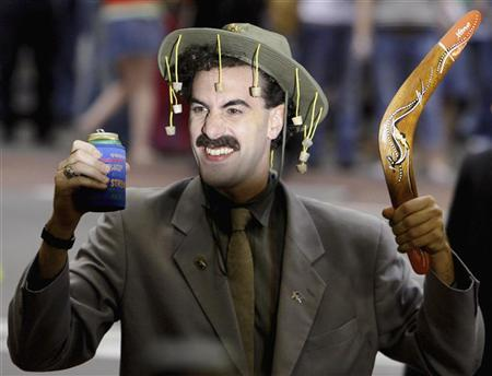 British actor Sacha Baron Cohen, in character as a Kazakh TV reporter known as 'Borat', holds a boomerang and can of beer in Sydney November 13, 2006 during the Australian premiere of his film ''Borat: Cultural Learnings of America for Make Benefit Glorious Nation of Kazakhstan''. REUTERS/David Gray (AUSTRALIA)