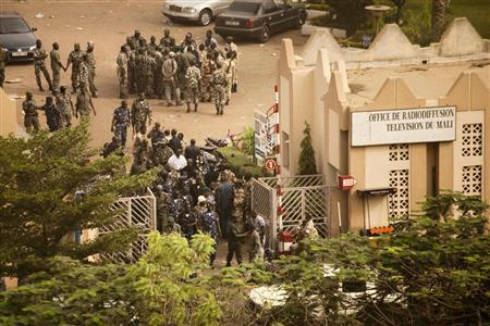 Malian soldiers and security forces gather at the offices of the state radio and television broadcaster after announcing a coup d'etat, in the capital Bamako, March 22, 2012. REUTERS/Malin Palm