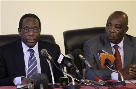 African Union Special Envoy for the Lord's Resistance Army (LRA) Francisco Madeira (L) flanked by Head of the United Nations Regional Office for Central Africa (UNOCA) Abou Moussa addresses a news conference in Entebbe, 35KM (22 miles), Southwest of Kampala, Uganda's capital, March 23, 2012. REUTERS/Edward Echwalu